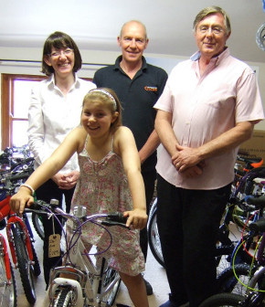 Lynne Shelton Steve Kucharik and Zdzislaw Krupski with the winner of the Heath Big Local Cleaner Streets and Parks Initiative competition Polly Jones on her new bike