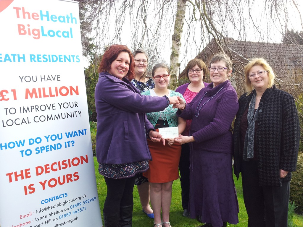Members of the Uttoxeter Autism Spectrum Group receive a cheque for £500 from the Heath Big Local