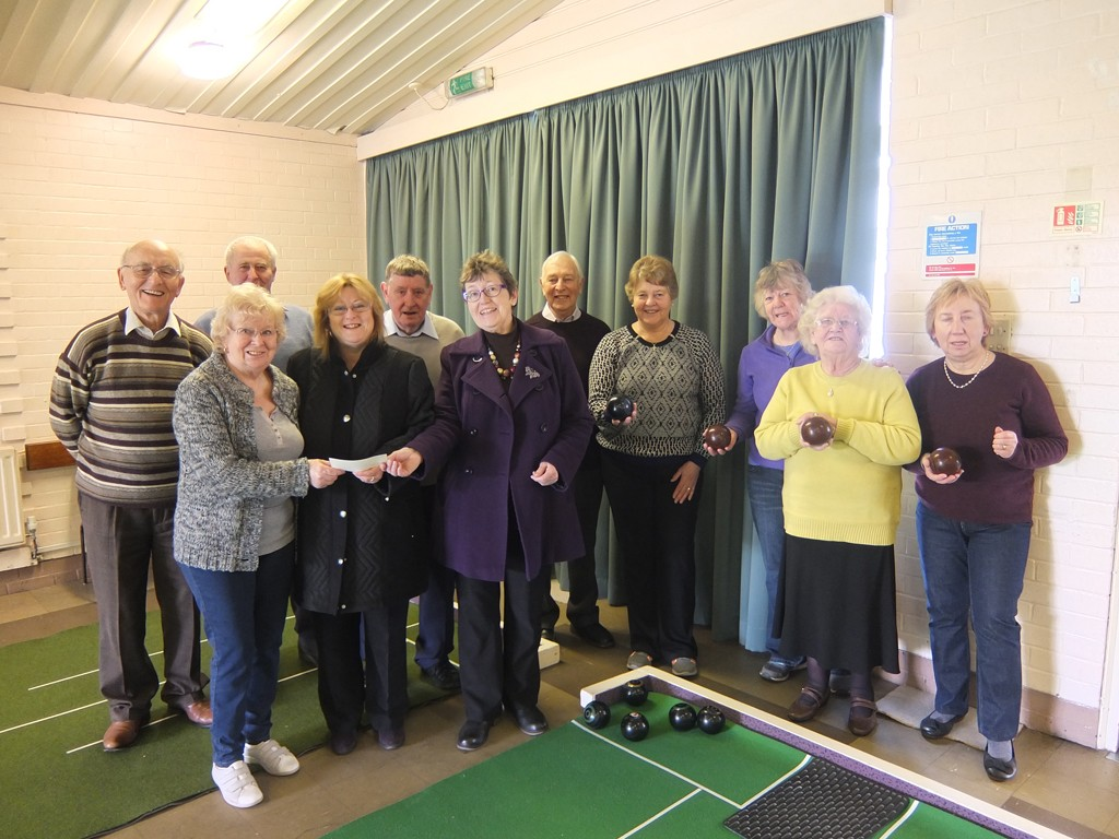 Uttoxeter Indoor Bowl Club receive a cheque for £700 toward a new bowls mat from Heath Big Local - Web